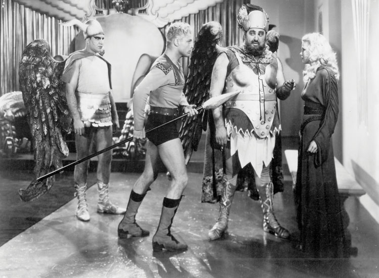 Flash Gordon (1936)  Directed by Frederick Stephani  Shown from left: Buster Crabbe (with spear), Jack 'Tiny' Lipson